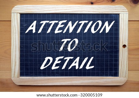 The phrase Attention To Detail in white text on a blackboard as a reminder that the little things are also important in business and life - stock photo