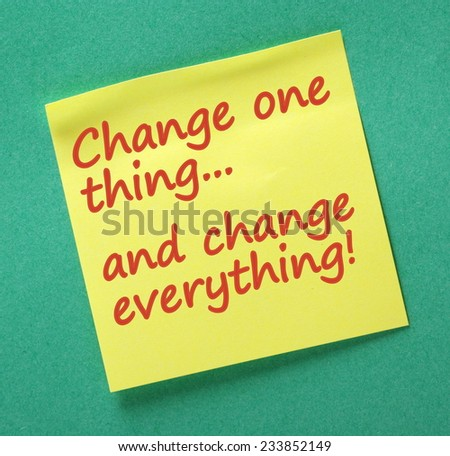 The phrase Change One Thing and Change Everything written on a yellow sticky note as a reminder that one change can make a difference to our desired outcomes or plans - stock photo