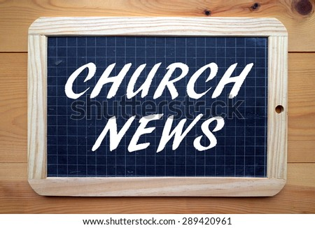 The phrase Church News in white text on a slate blackboard - stock photo