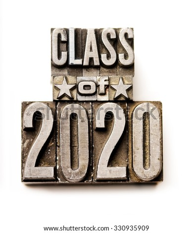 "The phrase ""Class of 2020"" in letterpress type. Cross processed, narrow focus."