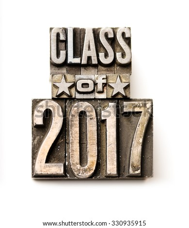 "The phrase ""Class of 2017"" in letterpress type. Cross processed, narrow focus."