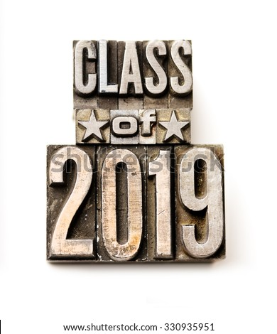 "The phrase ""Class of 2019"" in letterpress type. Cross processed, narrow focus."