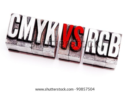 "The phrase ""CMYK vs RGB"" in letterpress type. Cross processed, narrow focus. - stock photo"
