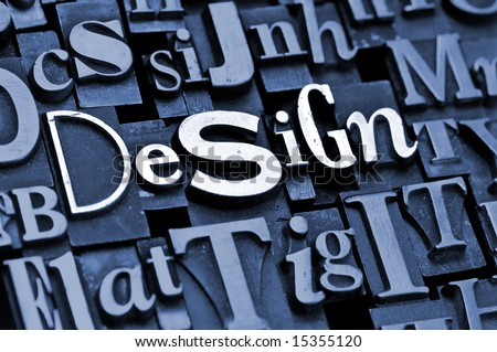 "The phrase ""Design!"" done with random letterpress type on a random letter background. - stock photo"