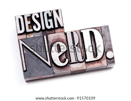 "The phrase ""Design Nerd"" in letterpress type. Cross processed, narrow focus. - stock photo"