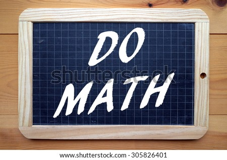 The phrase Do Math in white text on a blackboard as a reminder that Math is one of the core subjects of a rounded education - stock photo