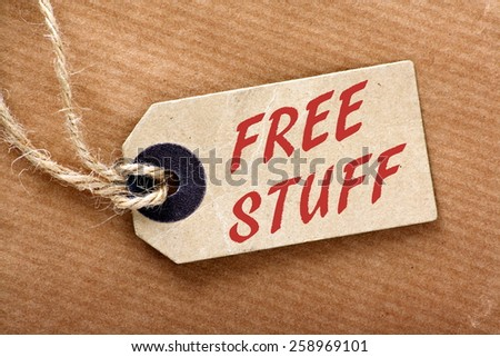 The phrase Free Stuff on a brown paper luggage tag on a brown wrapping paper background - stock photo