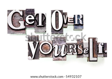 "The phrase ""Get Over Yourself"" in letterpress type. Cross processed, narrow focus. - stock photo"