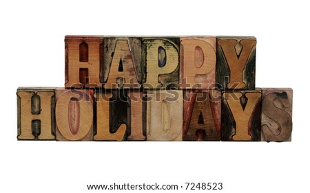 the phrase 'Happy Holidays' in letterpress wood letters isolated on white - stock photo