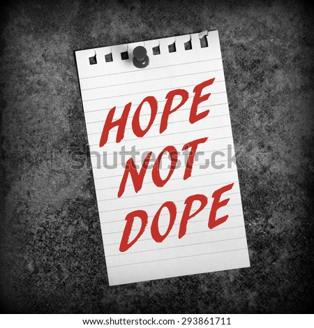 The phrase Hope Not Dope in red text on a sheet of paper pinned to a grunge background and processed in black and white for effect - stock photo