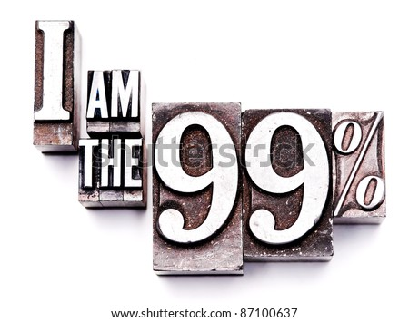 "The phrase ""I am the 99%"" in letterpress type. Cross processed, narrow focus. - stock photo"