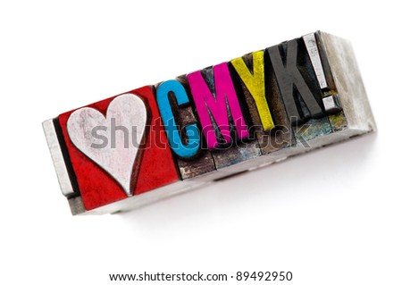 "The phrase ""I love CMYK"" in letterpress type, narrow focus macro. - stock photo"