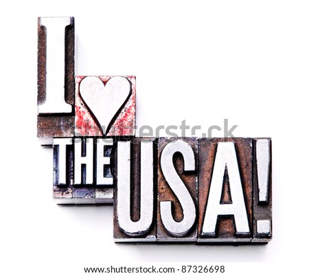 "The phrase ""I Love the USA!"" in letterpress type. Cross processed, narrow focus. - stock photo"