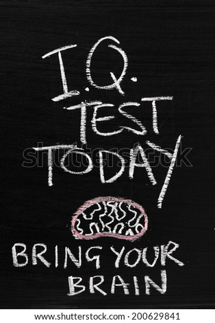 The phrase IQ Test Today written on a blackboard sign with a reminder to Bring Your Brain - stock photo