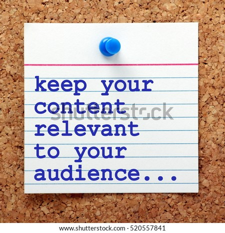 The phrase Keep Your Content Relevant to Your Audience in blue text on a note card pinned to a cork notice board as a reminder for your social media marketing strategy