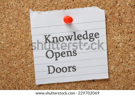 The phrase Knowledge Opens Doors on a piece of paper pinned to a notice board. A concept for creating opportunities via experience and education - stock photo