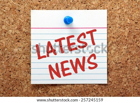 The phrase Latest News on a lined index card pinned to a cork bulletin board - stock photo