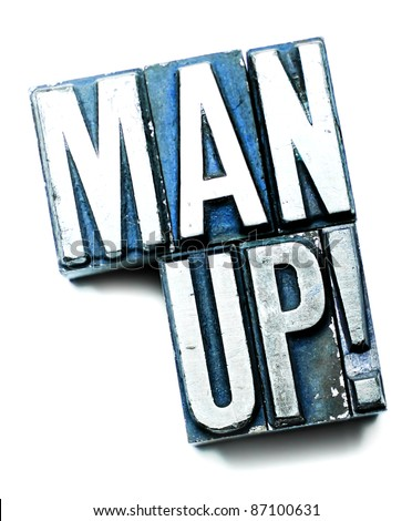 "The phrase ""Man Up!"" in letterpress type. Cross processed, narrow focus. - stock photo"