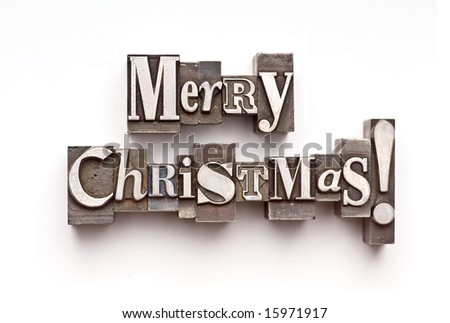 "The phrase ""Merry Christmas!"" done in letterpress type - stock photo"