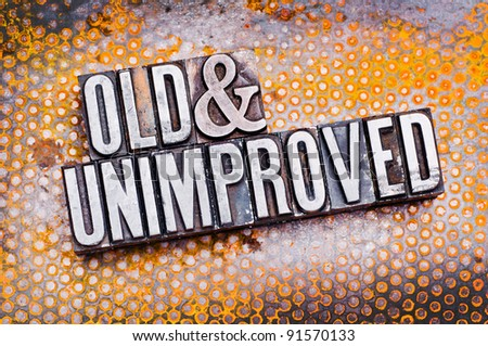 "The phrase ""Old and Unimproved"" in letterpress type. Cross processed, narrow focus. - stock photo"