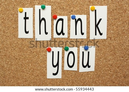 The phrase Thank You spelled out in letters pinned to a cork board - stock photo