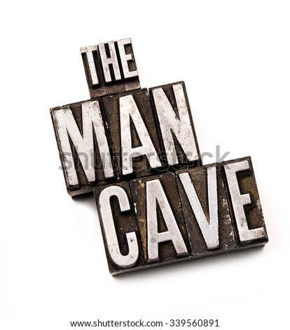 "The phrase ""The Man Cave"" in letterpress type. Cross processed, narrow focus."