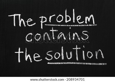 The phrase The Problem Contains The Solution written on a blackboard. In business or design the way forward is often found within the problem or issue itself