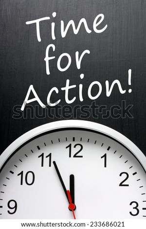 The phrase Time For Action on a blackboard above an office clock with the hands at almost twelve noon or midnight - stock photo