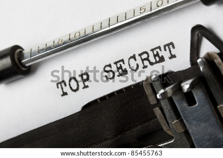 the phrase Top Secret written with old typewriter