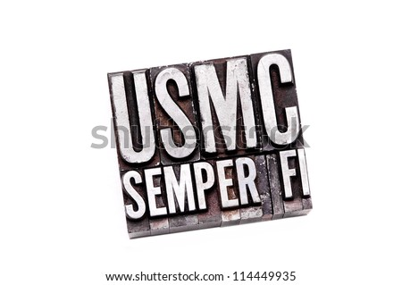 "The phrase ""USMC Semper Fi"" in letterpress type. Slight cross processed, narrow focus."
