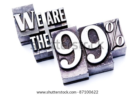 "The phrase ""We are the 99%"" in letterpress type. Cross processed, narrow focus. - stock photo"