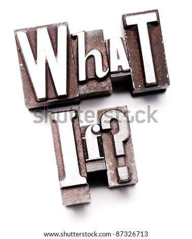 "The phrase ""What if?"" in letterpress type. Cross processed, narrow focus. - stock photo"