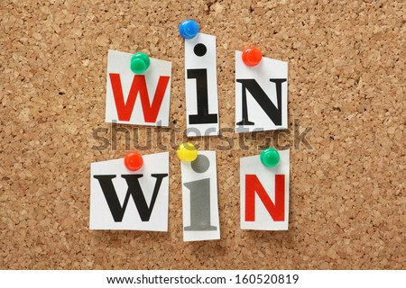 The phrase Win Win in cut out magazine letters pinned to a cork notice board. In any transaction or undertaking we look for mutual benefits and positive outcomes for all parties. - stock photo