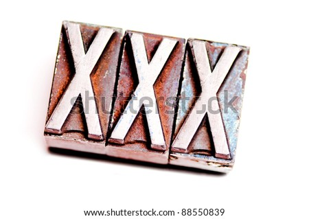 "The phrase ""XXX"" in letterpress type. Cross processed, narrow focus. - stock photo"