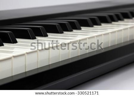 the piano keys closeup on white background - stock photo