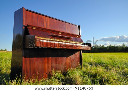 The piano outdoors. - stock photo