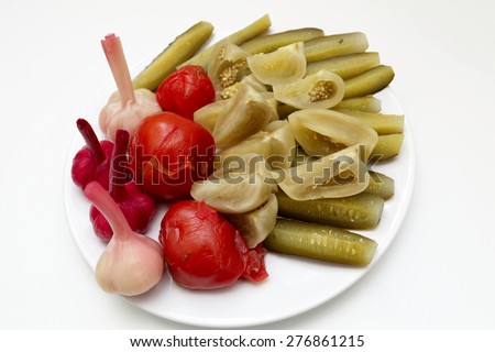 The pickled vegetables on the white plate - stock photo