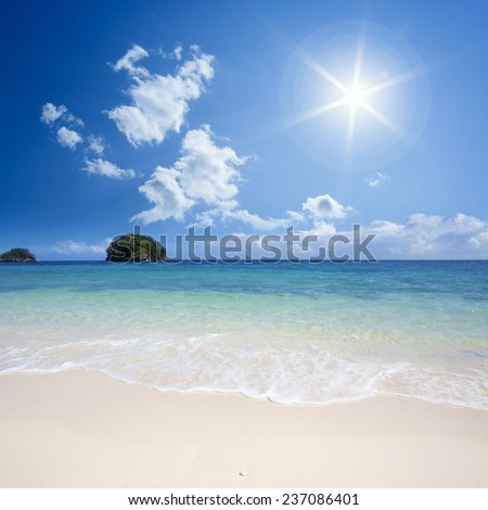 The picture from the tropical island. Tender surf and warm sea. A fine place for holiday, treatment and restoration of forces. Bathing and water sports. - stock photo