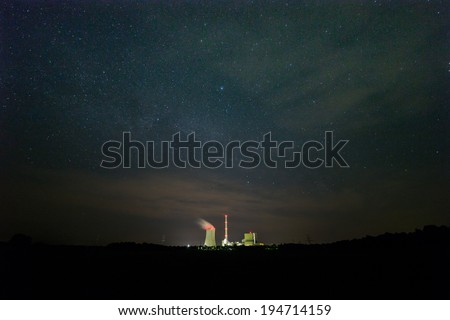 The picture shows a coal power plant at night. - stock photo