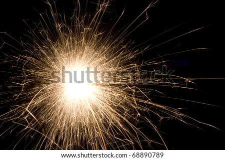 The picture shows a sparkler on black background . - stock photo