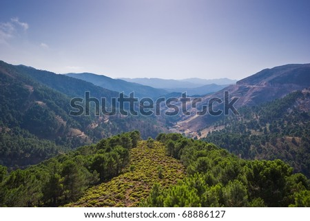 The picture shows mountains and a sunny blue sky at the Costa del Sol in Spain. - stock photo