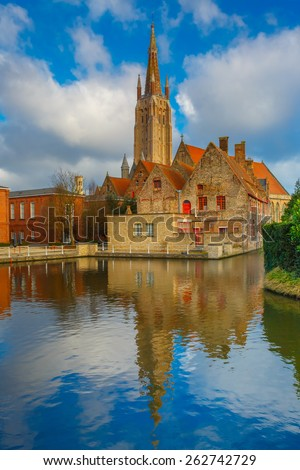 The picturesque city landscape with a lake, Old St. John's Hospital and the Church of Our Lady in Bruges, Belgium - stock photo