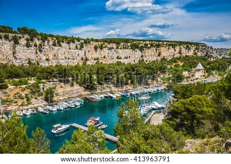 The picturesque fjord with turquoise water at coast of the Mediterranean Sea.park of Calanques in Provence, between Marseille and Kassis.  White and graceful sailing yachts in the deep sea gulf - stock photo