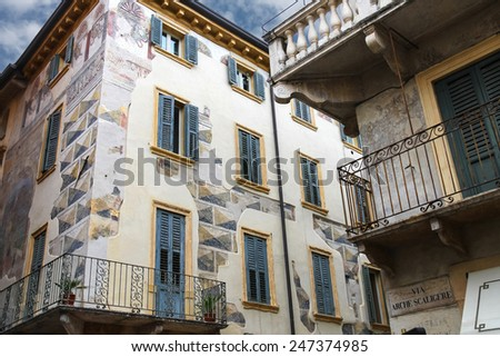 The picturesque house with murals on the street via Arche Scaligere in Verona, Italy - stock photo