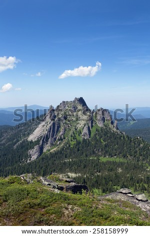 The picturesque landscape of Stone Town in the Western Sayan mountains on a sunny summer day - stock photo