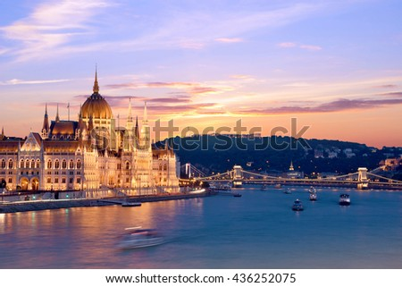 The picturesque landscape of the Parliament and the bridge over the Danube in Budapest, Hungary, Europe at sunset - stock photo