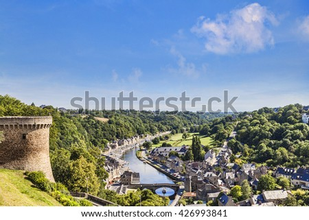 The picturesque medieval port of Dinan on the Rance Estuary, Brittany, France, seen from the walls of the fortified city.