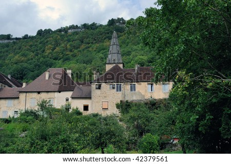 The picturesque village of Baume-les-Messieurs The abbey is famous for its sixteenth-century retable - stock photo
