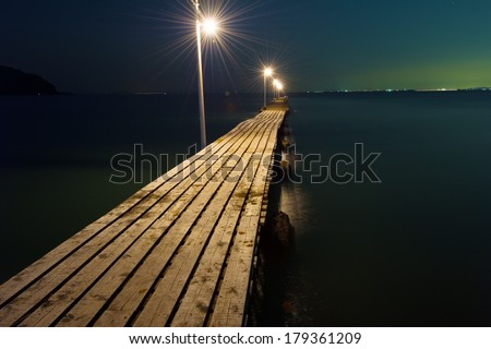 The Pier Against Dark Sea, Chiba Prefecture/Japan, 2013/4/28.  - stock photo