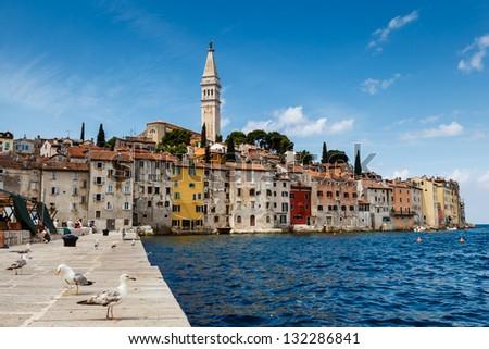 The Pier and the City of Rovinj on Istria Peninsula in Croatia - stock photo